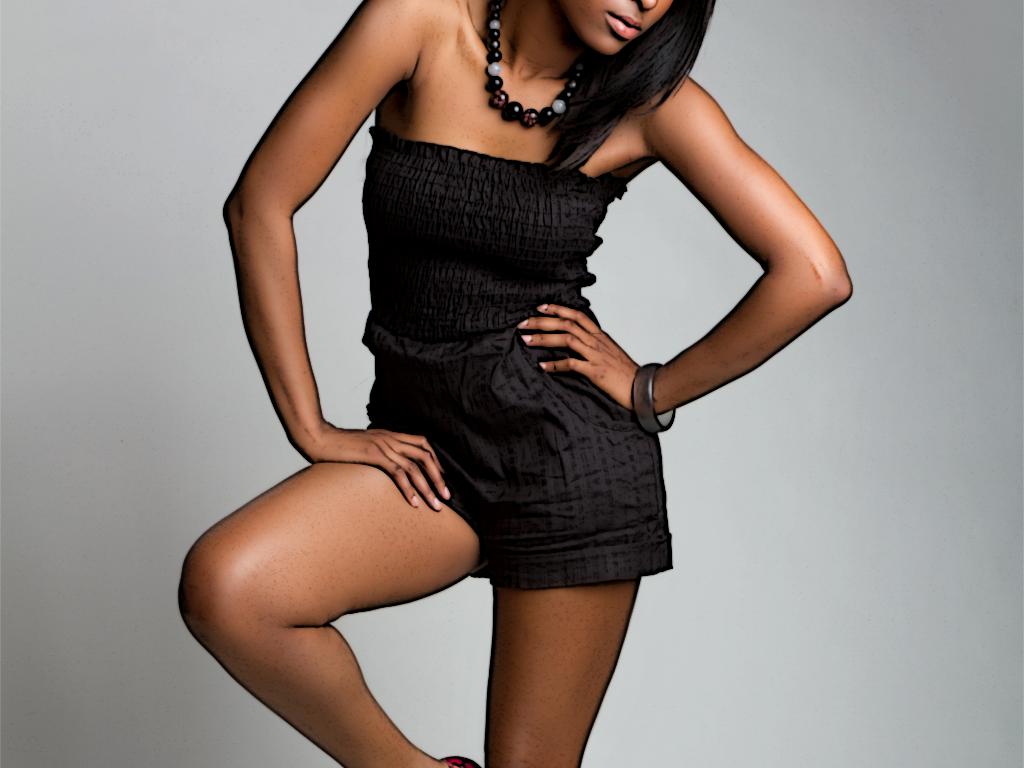 a black model in a black jumper