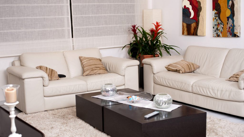 a living room with taupe furniture