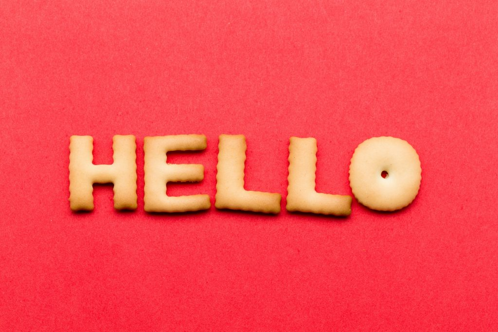 Word hello cookie over the red background