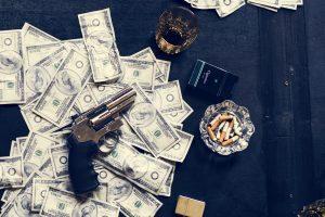 Gun on money on the table