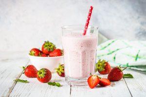 Strawberry smoothie or milkshake at white
